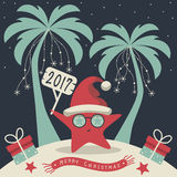 Merry Christmas and Happy New Year. The cover design. Christmas on the island. Depicts two palm trees, a sea star in Santa Claus hat, garlands of snowflakes Royalty Free Stock Photography