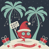 Merry Christmas and Happy New Year. The cover design. Christmas on the island. Depicts two palm trees, a shark in Santa Claus hat, garlands of snowflakes Royalty Free Stock Images