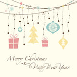 Merry Christmas and Happy New Year. The cover design. Shows a variety of decorative garland of Christmas decorations. At the bottom of the postcard the phrase Royalty Free Stock Photography