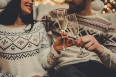 Couple celebrating New Year at home stock photography