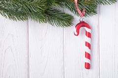 Merry Christmas and Happy New Year. Christmas decorations glass candy cane and christmas tree branch. Free space. Merry Christmas and Happy New Year. Christmas stock photo