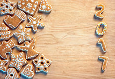 Merry Christmas and Happy new year! Delicious cookies on wooden background. Royalty Free Stock Images