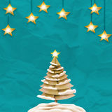 Merry christmas and happy new year. Fancy  xmas tree on color paper background Royalty Free Stock Images