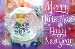Merry Christmas and Happy New Year festive card with snow globe and Christmas-tree tinsel. Snow glass ball with moose toy. Royalty Free Stock Photos