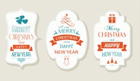 Merry Christmas and Happy New Year, Flat label set. Set of Christmas and New Years labels with various Christmas symbols and the wording, Merry Christmas and Royalty Free Stock Photography