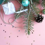 Merry Christmas and Happy New Year. Frame Christmas Card Festive with green Fir Branches and Holiday Object on pale pink and blue Background Royalty Free Stock Photos