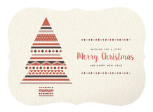 Merry christmas happy new year geometry tree shape. Merry christmas happy new year design: retro xmas tree made of geometry shapes on paper texture background Royalty Free Stock Images