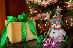 Merry Christmas and Happy new year, gift box with snowman. Near christmas tree Royalty Free Stock Photos