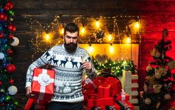 Merry christmas and Happy new year. Gift emotions. Bearded modern santa claus in knitted sweater. Merry christmas and Happy new year. Gift emotions. Bearded stock images