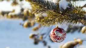 Merry Christmas and Happy New Year. Glass toy on the tree. Merry Christmas and Happy New Year. Glass toy on the Christmas tree stock photo