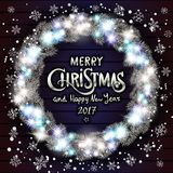 Merry Christmas and Happy New Year 2017. Glowing Christmas wreath. Merry Christmas and happy New Year Lettering label. Glowing Christmas Lights Wreath for Xmas Stock Photo