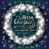 Merry Christmas and Happy New Year 2017. Glowing Christmas wreath. Merry Christmas and happy New Year Lettering label. Glowing Christmas Lights Wreath for Xmas Stock Image