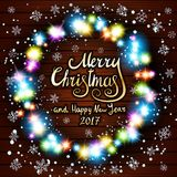 Merry Christmas and Happy New Year 2017. Glowing Christmas wreath. Made of led lights on the wooden background art Royalty Free Stock Image