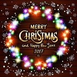 Merry Christmas and Happy New Year 2017. Glowing Christmas wreath. Made of led lights on the wooden background art Royalty Free Stock Images
