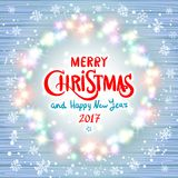 Merry Christmas and Happy New Year 2017. Glowing Christmas wreath. Made of led lights on the wooden background. Decorative christmas background with lights and stock illustration