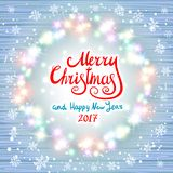 Merry Christmas and Happy New Year 2017. Glowing Christmas wreath. Made of led lights on the wooden background. Christmas lights background. art Stock Images