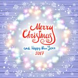 Merry Christmas and Happy New Year 2017. Glowing Christmas wreath. Made of led lights on the wooden background. Christmas lights background. art Stock Image