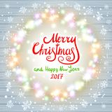 Merry Christmas and Happy New Year 2017. Glowing Christmas wreath. Made of led lights on the wooden background. Christmas lights background. Christmas Stock Images