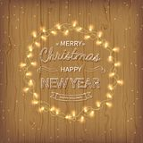 Merry Christmas and Happy New Year golden Greeting Background. Beautiful logo lettering with garlands, golden confetti tinsel. On a wooden background. Xmas card Stock Images