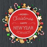 Merry Christmas and Happy New Year  Greeting Background. Logo lettering with sweets, cookie, lollipops. On a wooden black table. For web or printing Top View Stock Photos