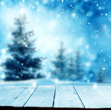 Merry christmas and happy new year greeting background with tabl. E .Winter landscape with snow and christmas trees Royalty Free Stock Photos