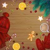 Merry Christmas and Happy New Year Greeting Background. Winter Elements fir branches, knitted red hat, mittens. On a wooden table. Top View Stock Image