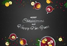 Merry Christmas and Happy New Year Greeting Background.. Winter traditional drink punch in a bowl and cups, oranges, apples, spices, cardamom, cinnamon, anise Stock Photo