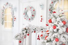 merry christmas happy new year greeting card white house decorated tree and toys royalty free stock image