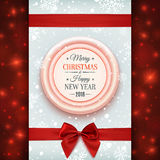 Merry Christmas and Happy New Year greeting card. Merry Christmas and Happy New Year badge with red ribbon and a bow, on winter background with snow and Royalty Free Stock Image