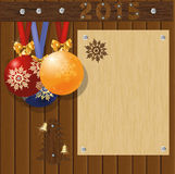 Merry Christmas and Happy New Year greeting card board with balls Royalty Free Stock Photos