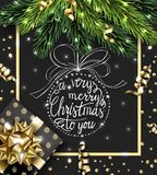 Merry Christmas and Happy New Year greeting card with with Christmas branches, with Christmas gift, with decorations on. Dark background Vector template Stock Illustration