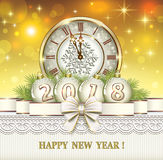2018 Merry Christmas and Happy New Year. Greeting card with a clock and balls is decorated with a bow Stock Photo