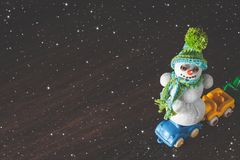 Christmas and new year snowman and cars model Royalty Free Stock Photos