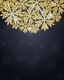 Christmas gold glittering snowflakes background Stock Photo