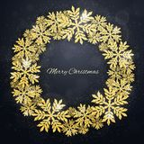 Christmas gold glittering snowflakes background Stock Image