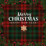 Merry Christmas and Happy New Year greeting card, invitation. Christmas tree branches, red berries border and gingerbread star. Wh. Ite text over tartan Stock Photos