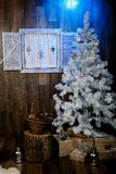 Merry Christmas and happy New Year greeting card. Christmas tree with decorations and blue light stock images
