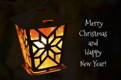 Merry Christmas and Happy New Year greeting card with vintage yellow garland light on a dark background.Retro light bulb. Winter holidays concept.Selective royalty free stock images
