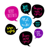 Merry Christmas and Happy New Year greeting phrases. Merry Christmas and Happy New Year greetings in speech bubbles.  Bright design element for  poster, greeting Royalty Free Stock Photography