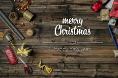 Merry Christmas and happy new year greetings in vertical top view vintage wood.handicraft tools,ribbons,gift present. Boxes decorated frame.Xmas winter holiday stock photos