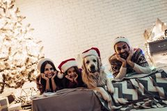 Family with dog on New Year`s Eve stock photography