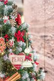 Merry Christmas and Happy New Year. Happy holidays. Christmas tree. Heart with inscription peace. Free space. Merry Christmas and Happy New Year. Christmas tree Royalty Free Stock Photo