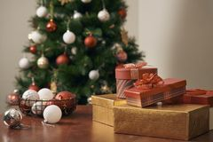 Merry Christmas and Happy New year Holidays! Decorating the Christmas tree indoors. Macro or close picture of xmas tree and gifts.  royalty free stock image