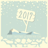 Merry Christmas and Happy New Year. Iceberg with a sign and numbers two, zero, one and seven on it. Under the iceberg ice and the phrase merry Christmas and Royalty Free Stock Photos