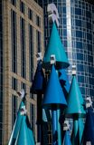 Merry Christmas and happy New Year!. The idiosyncratic Christmas tree is placed on the Plaza of the building Royalty Free Stock Photos