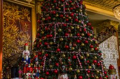 Merry Christmas and happy New Year!. The idiosyncratic Christmas tree is placed in the Plaza of the building Stock Image