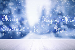 Merry Christmas and Happy New Year lettering at winter forest ba Royalty Free Stock Photo
