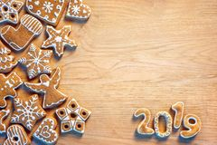Merry Christmas and Happy new year!. Homemade ginger cookies on wooden table. Copy space for your text. Top view. Christmas baking concept royalty free stock images