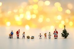 Merry christmas and happy new year Miniature People : Children w. Ith Santa Claus doll and his reindeer on white background,in Christmas festival royalty free stock photos