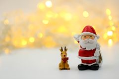 Merry christmas and happy new year Miniature People : Children w. Ith Santa Claus doll and his reindeer on white background,in Christmas festival royalty free stock images